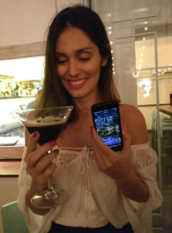 Bruna Abdullah holding a glass of Expresso Martini