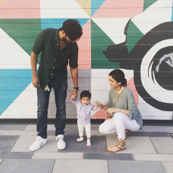 Dulquer Salmaan with his wife and daughter