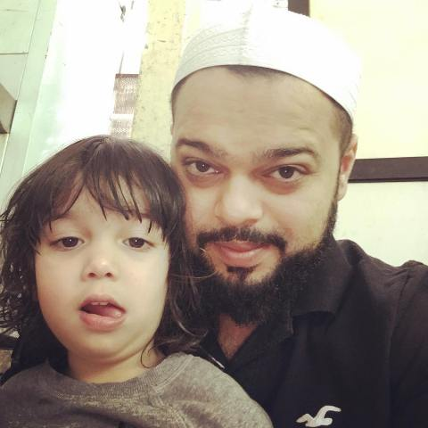 Farhan Azmi with his son