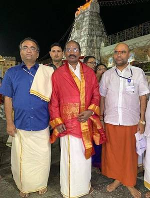 K Sivan while visiting a temple