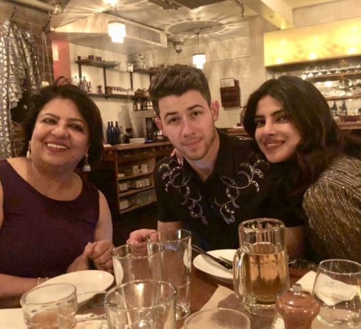 Madhu Chopra with her daughter and son-in-law