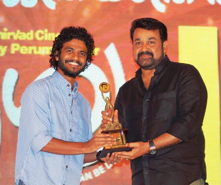Neeraj Madhav Receiving an Award