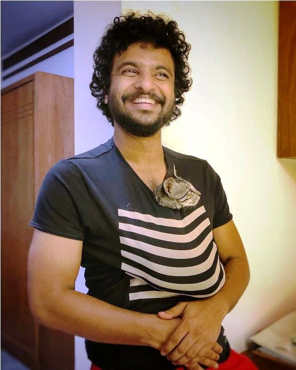 Neeraj Madhav with a Cat