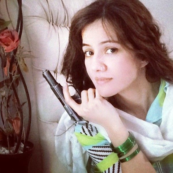 Rabi Pirzada Posing with Her Pistol