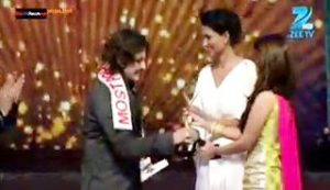 Rajat Tokas receiving an award