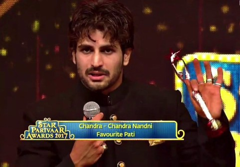 Rajat Tokas with an award