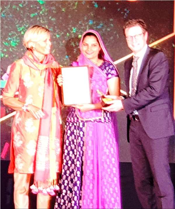 Ruma Devi Receiving Award