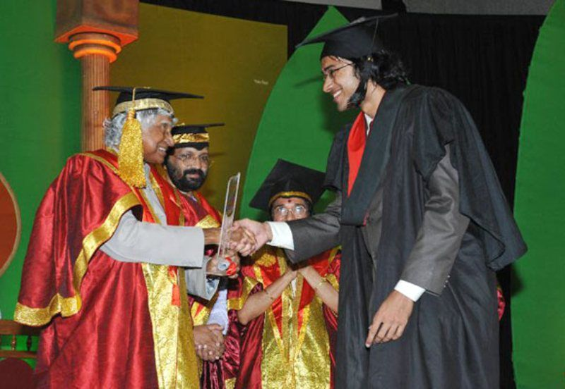 Sriram Venkitaraman receiving his medical degree from APJ Abdul Kalam