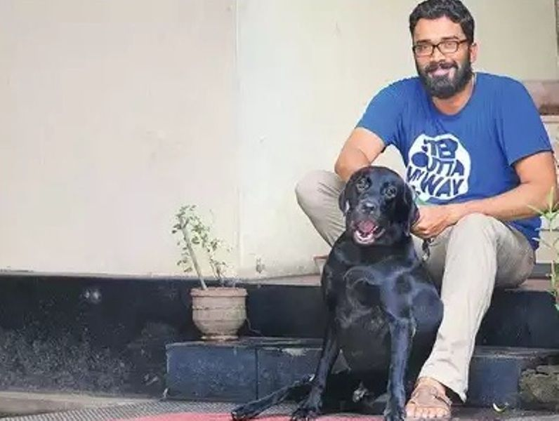 Sriram Venkitaraman with his dog Ray
