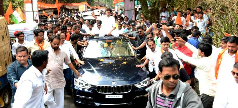 Aditya Thackeray on his car during a rally