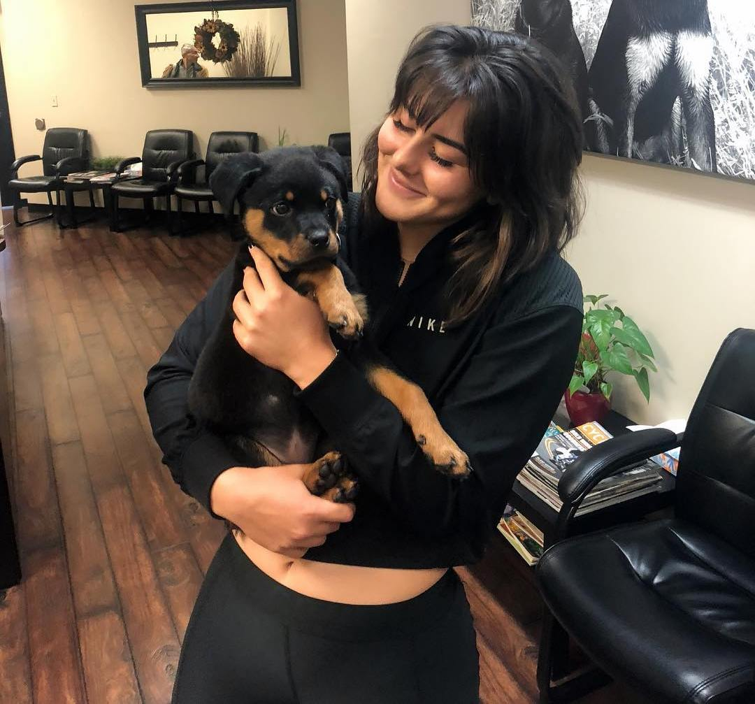 Bianca Andreescu holding a stray dog