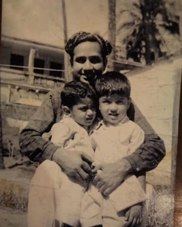 Childhood Photo of Abu Malik with his brother and father