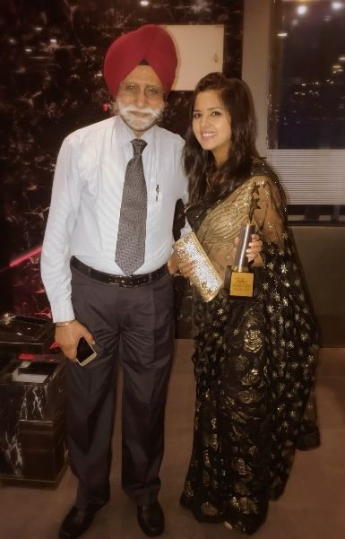 Dalljiet Kaur with her father