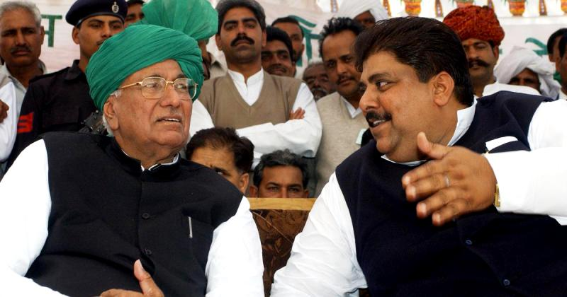 Dushyant Chautala's father Ajay Singh Chautala (right) and his grandfather Om Prakash Chautala (left)