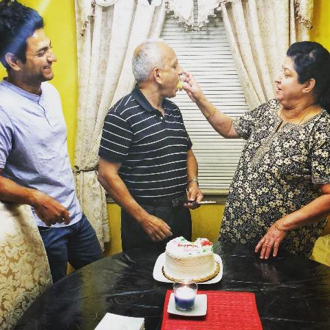 Kenny Sebastian with his parents