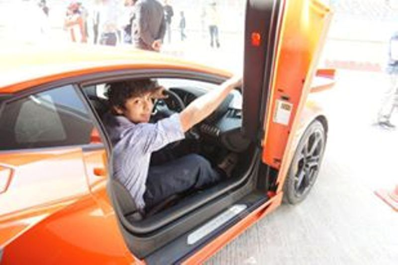 Shikhar Pahariya posing with his car