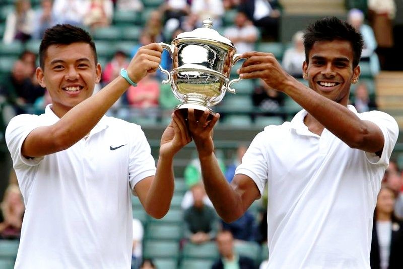 Sumit Nagal with Lý Hoàng Nam after winning the Boys' Doubles at Wimbledon