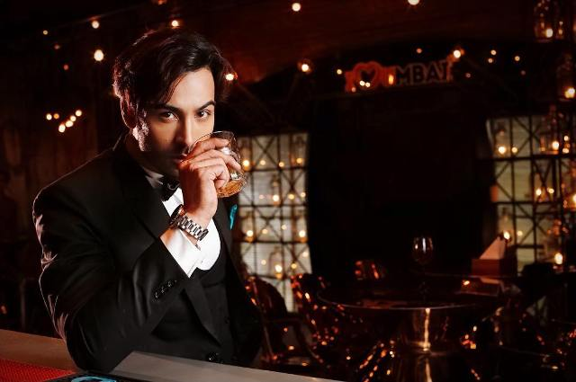 Arhaan Khan with a glass of alcohol