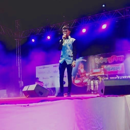 Azmat Hussain performing on a stage show