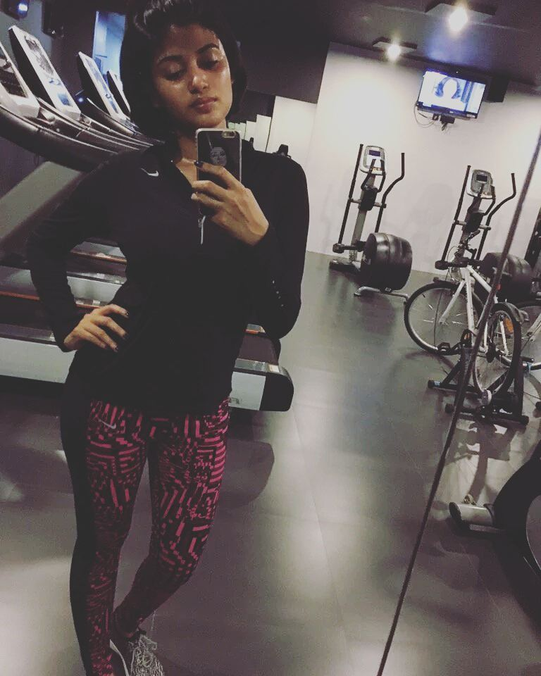 Oviya Helen posing in the gym