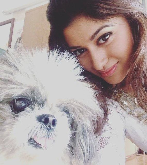 Oviya Helen with her pet dog