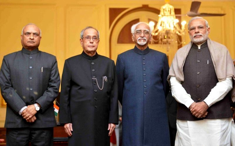RK Mathur (extreme left) with Pranab Mukherjee (left), Hamid Ansari (right), and Narendra Modi (extreme right)