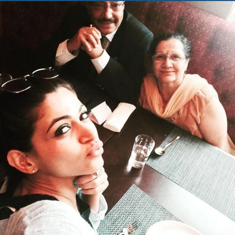 Reyhna Malhotra with her parents