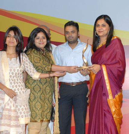 Richa Anirudh being felicitated with an award