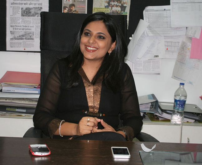Richa Anirudh sitting in her office