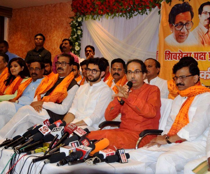 Sanjay Raut with Uddhav Thackeray and Aditya Thackeray during a press conference
