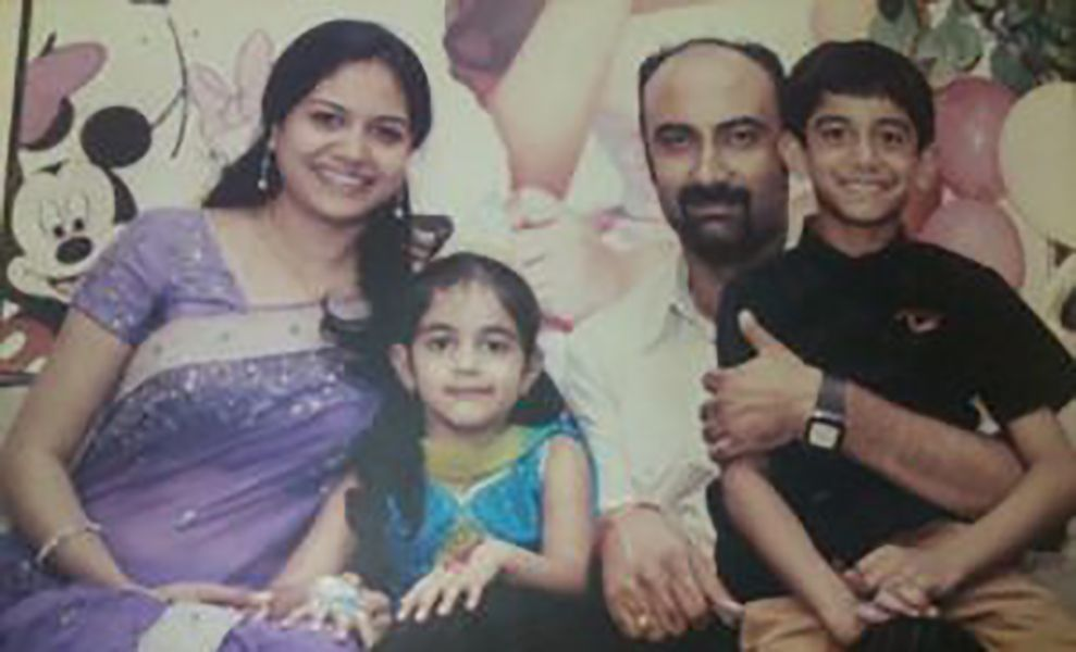 Sunitha Upadrashta with her husband and children