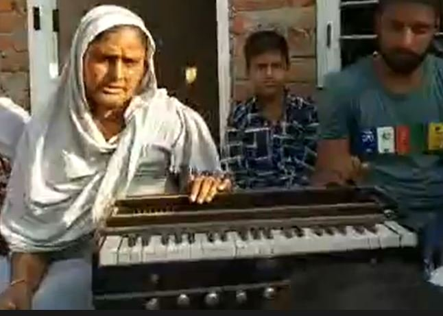 Sunny's mother with his Harmonium