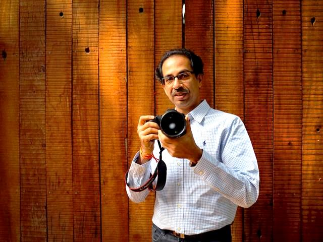 Uddhav Thackeray posing with a camera