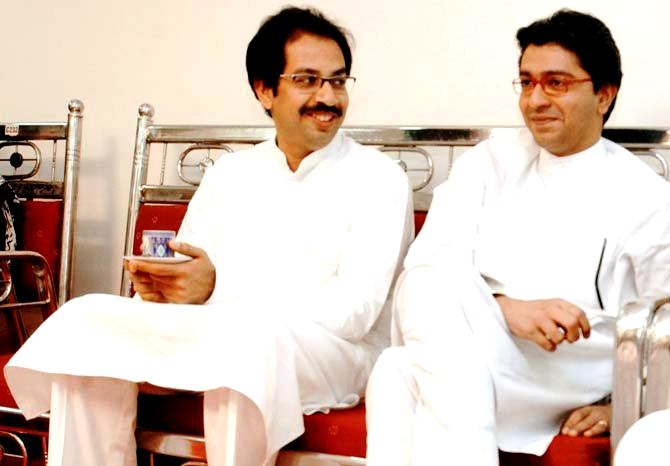 Uddhav Thackeray with Raj Thackeray (right)