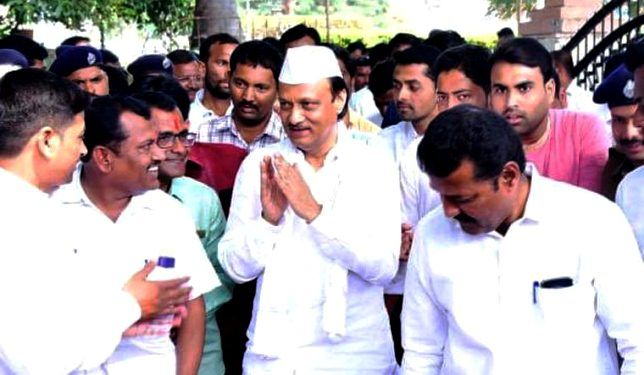 Ajit Pawar being greeted by NCP workers
