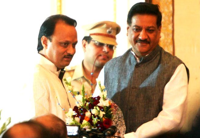 Ajit Pawar with Prithviraj Chavan after being sworn-in as the Deputy CM of Maharashtra in 2012