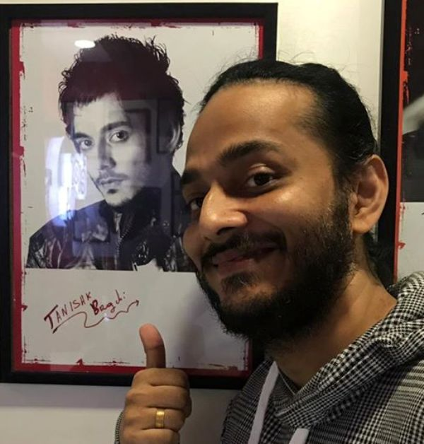 Kanishk Bagchi posing with his photo and Autograph