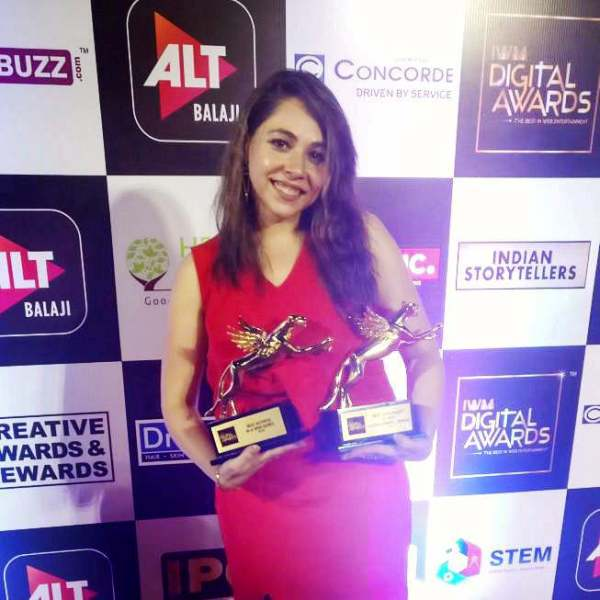 Maanvi Gagroo Posing with Her Awards
