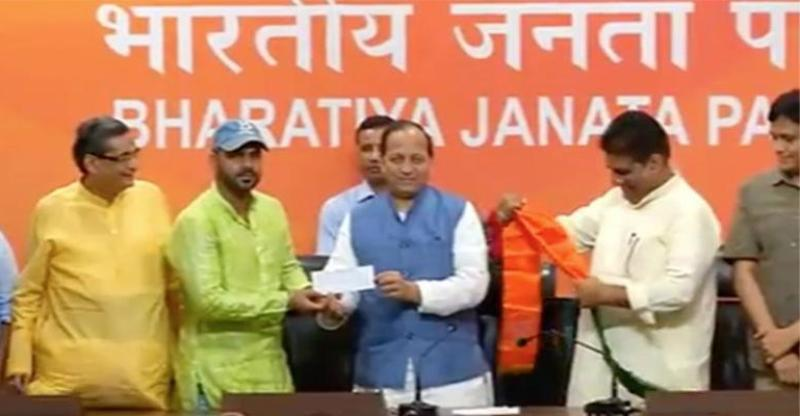 Pawan Singh being inducted into BJP