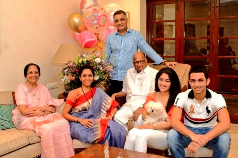 Supriya Sule with her father Sharad Pawar (centre), mother Pratibha Sule (extreme left), husband Sadanand Sule (top), daughter Revati Sule, and son Vijay Sule (extreme right)