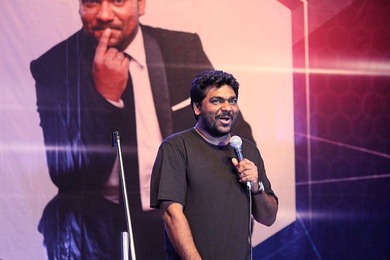 Zakir Khan performing on stage