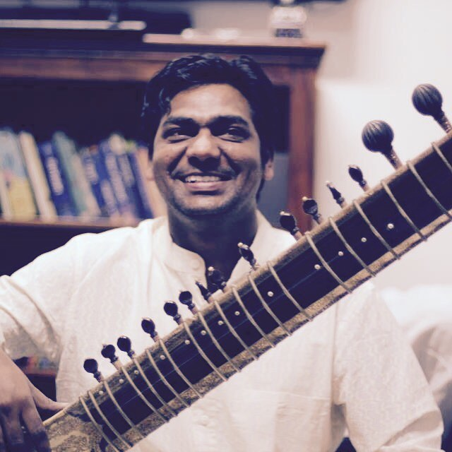 Zakir Khan playing a Sitar