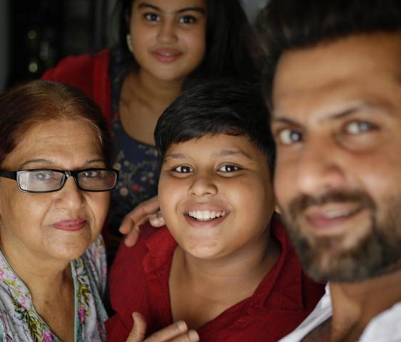 Aamir Dalvi with his mother and kids