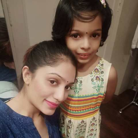 Arya Rohit with her daughter