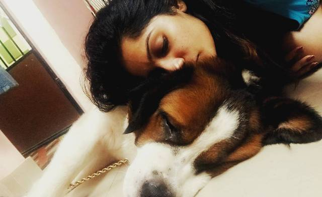 Arya Rohit with her pet dog