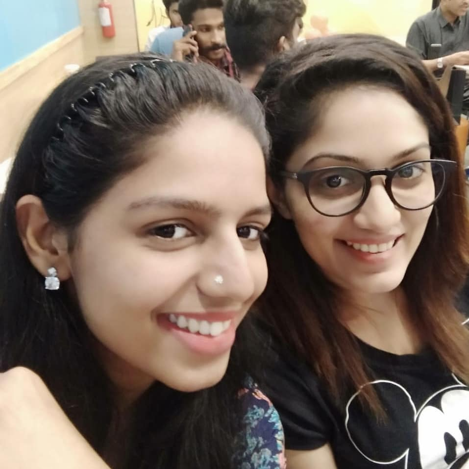 Arya Rohit with her sister