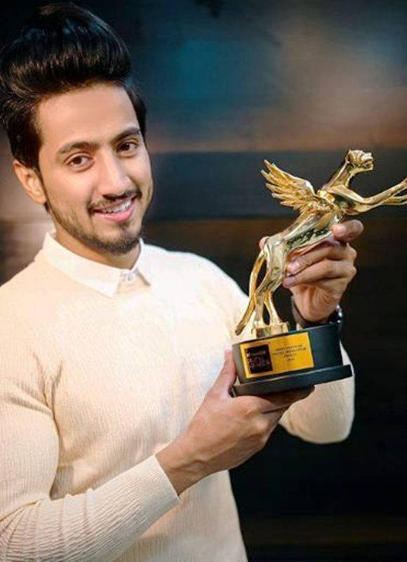 Faisal Shaikh with His Award