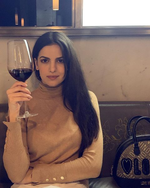 Natasa Stankovic holding a glass of wine