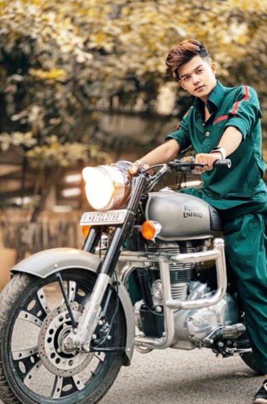 Riyaz Aly Posing on His Bike