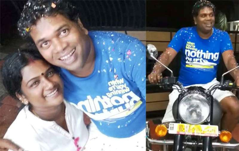 Saju Navodaya with His Wife and Motorcycle
